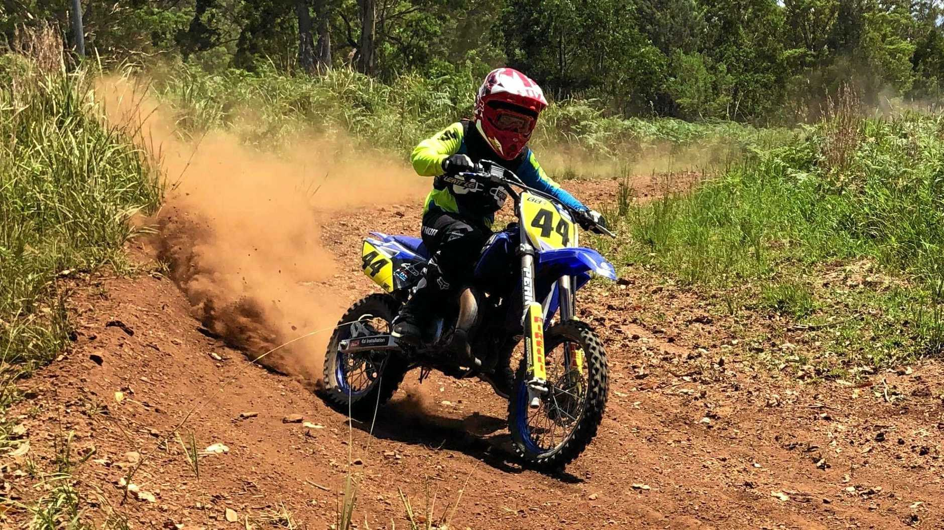 One of Bayden Blanchett's family riding on the motocross track on his property.