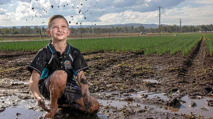 MUDDY FUN: Levi Gehrke plays in the mud after rain at Campsey Ash Farms in Lake Clarendon.
