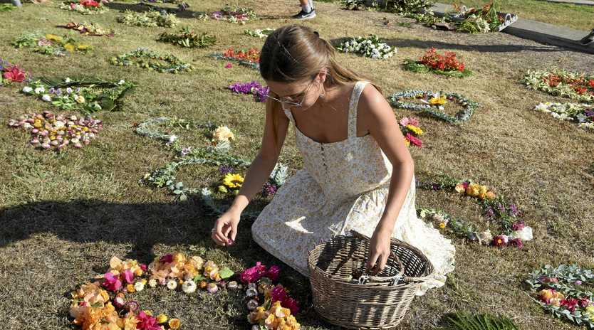 IN MOURNING: Lucy Hackett lay flowers at the memorial.