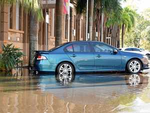 Heavens pour down and trap cars in Rockhampton's CBD