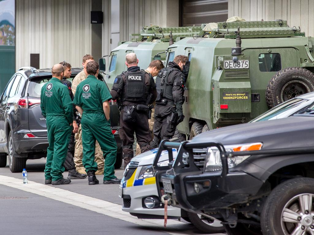 Police are seen at the Christchurch District Court precinct for the arrival of the alleged gunmanon charges of murder.