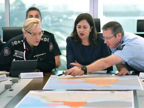 Queensland Fire and Emergency Services Commissioner, Katarina Carroll (left), Queensland Premier Annastacia Palaszczuk (centre) and Queensland Police Deputy Commissioner Bob Gee (right) are seen during a meeting of the Queensland Disaster Management Committee in response to Tropical Cyclone Trevor. Picture: AAP Image/Darren England