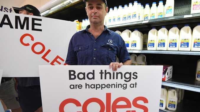 Queensland dairy farmers protest inside a Coles supermarket store in Brisbane.