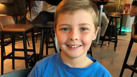 John Meredith (9) was an unaccompanied minor who was travelling to Sydney to see his grandmother when his plane was diverted to Melbourne. His parents were left in the dark overnight about his arrangements.