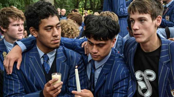 School students attend a vigil in Christchurch.