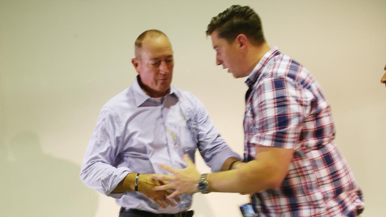 Senator Fraser Anning cleans egg off himself. Picture: AAP Image/David Crosling