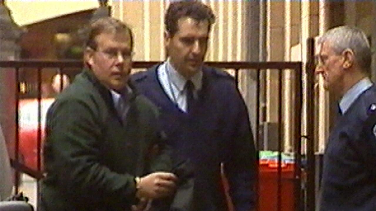 Paul Margach is taken away after sentencing.