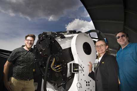 SPACE AGE: At the launch of USQ's expansion of the Mount Kent Observatory are (from left) PhD student Jake Clark, Dr Belinda Nicholson and Dr Jonti Horner, pictured here with a telescope.
