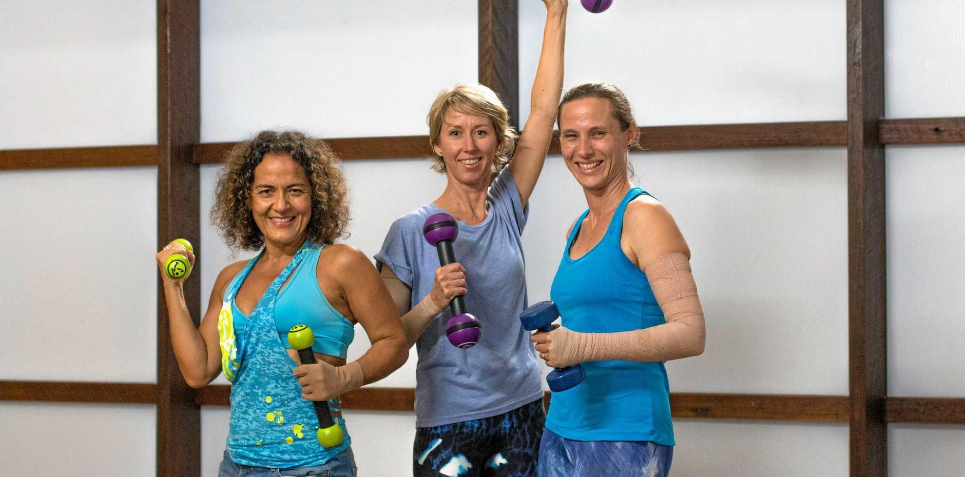 GET PHYSICAL: Nella Del Castillo, Suzi Yuki and Caroline Kohl beef up their energy levels.