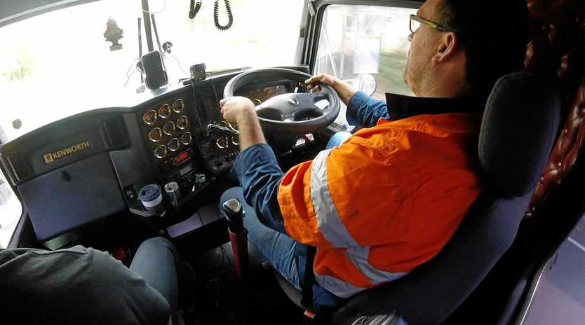 FIELD TESTING: Multiquip driver Damo helps Andrew gather heart data while on a run behind the wheel of a Kenworth T408 SAR.