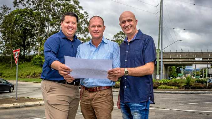 UPGRADE PROMISED: Reece Byrnes, Labor's Craig Elliot and Troy Green with the plans for upgrades to Kennedy Dr.