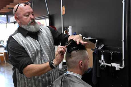 Barber Rex Silver in his Bourbong Street premises.