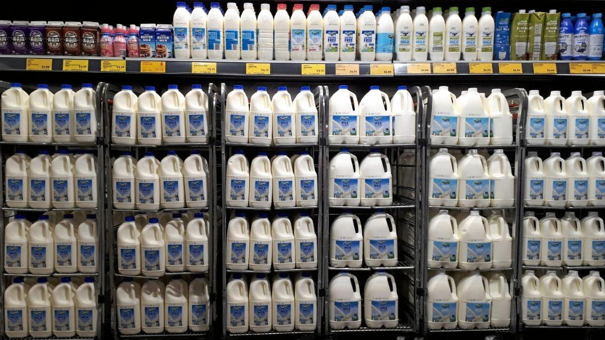 Coles and Aldi are increasing the price of their milk.
