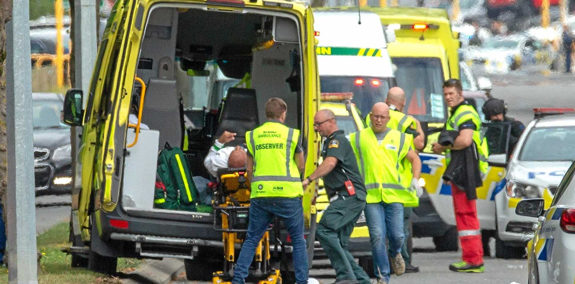 An injured person is loaded in an ambulance following a shooting at the Masjid Al Noor mosque in Christchurch, New Zealand, Friday, March 15, 2019.
