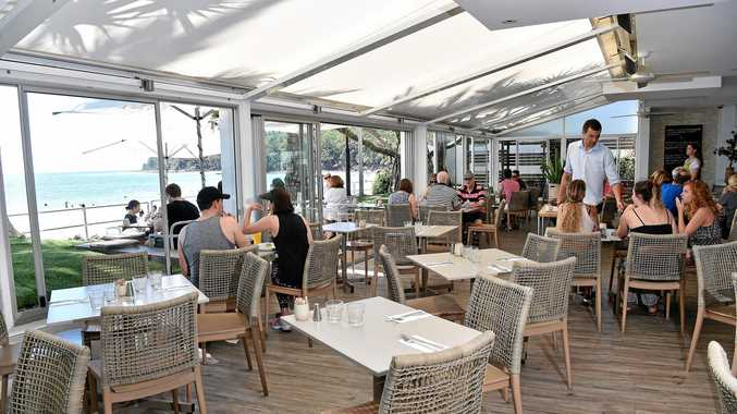 Inside dining with a view of Main Beach.