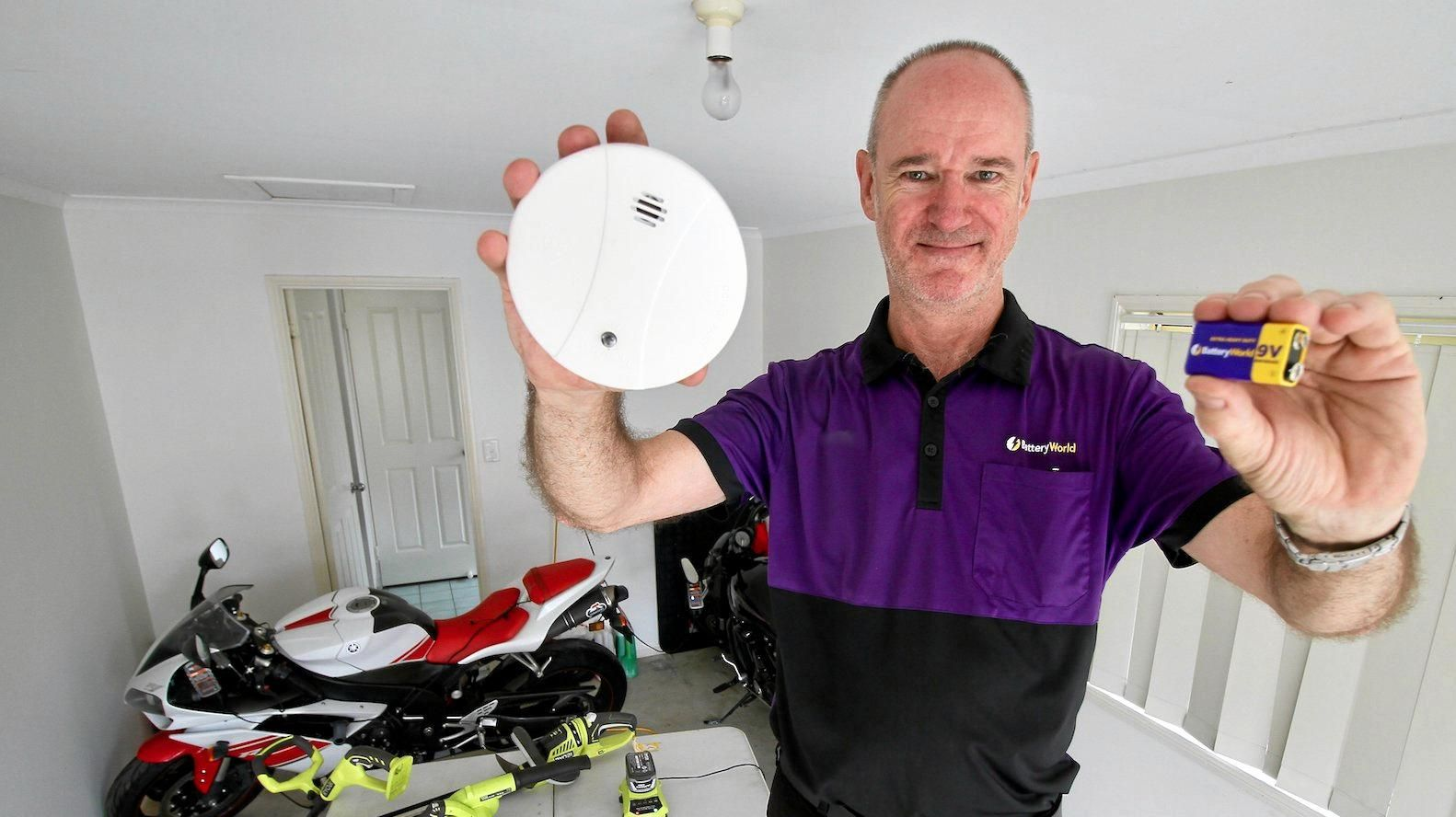FREE FOR OLD: Battery World Gladstone staff member David Atkinson. The local business will be swapping old smoke alarm batteries for new ones for free.