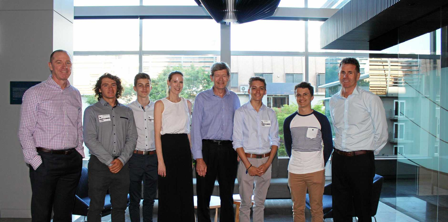 NEXT GENERATION: Bartholomew Dickman (second from left), Jack McDonald (third left), Justin Gleeson (third right) and Benjamin Smythe (second right) with CS Energy CEO Andrew Bills (far right), executive general manager Andrew Varvari (far left), principal engineer David Bell (centre) and HR administrator Jillian Evans.