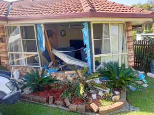 Mother and kids escape injury after car rolls into house