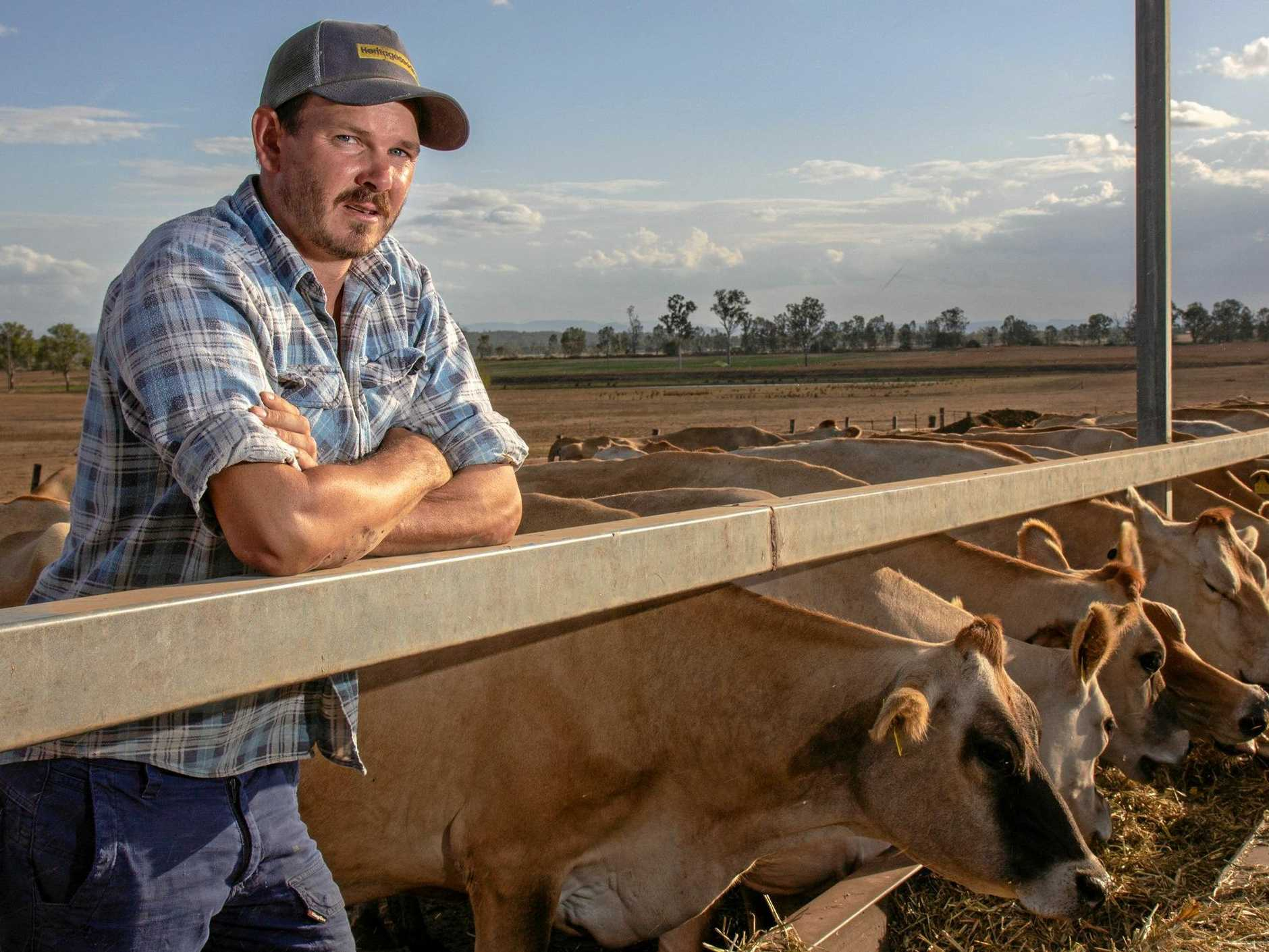 TOO LATE: Mt Tarampa dairyfarmer Richard Peterkin said the decision by Coles and Aldi to raise their home brand milk by 10c-a-litre was a step in the right direction, but also labelled it a PR stunt.