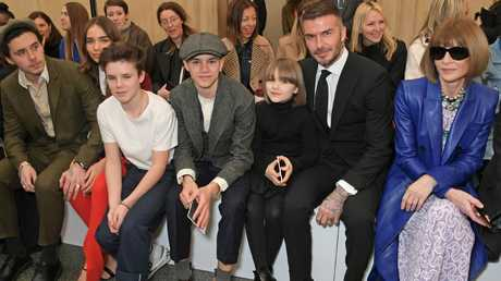 The Beckhams (with Anna Wintour) at London Fashion Week. Picture: Getty Images