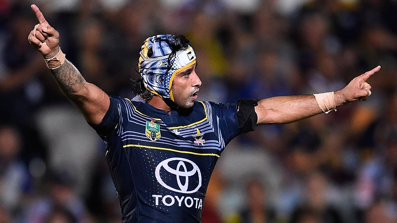Johnathan Thurston celebrates his winning field goal. Picture: Ian Hitchcock