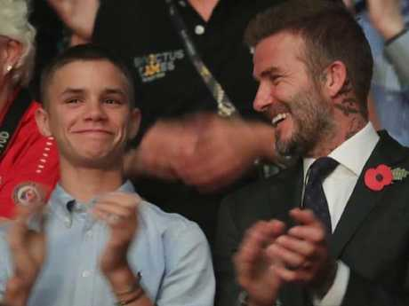 Romeo Beckham and his famous dad. Picture: Supplied