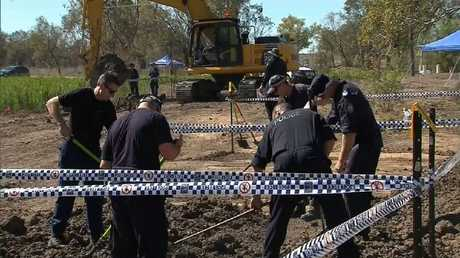Tip.... Police officers search industrial estate in Walgett