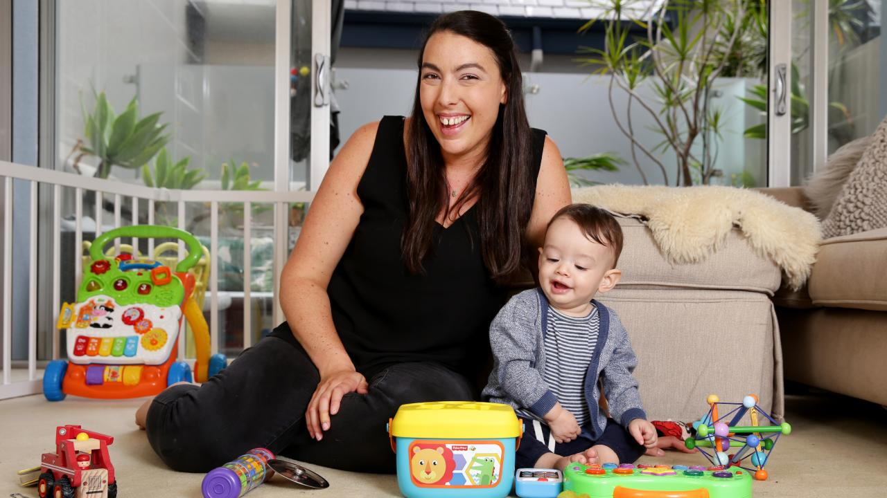 Carla Zipper, 36, with her son 11-month-old Evan at their Manly unit. She is looking to buy a bigger home after selling her investment property.