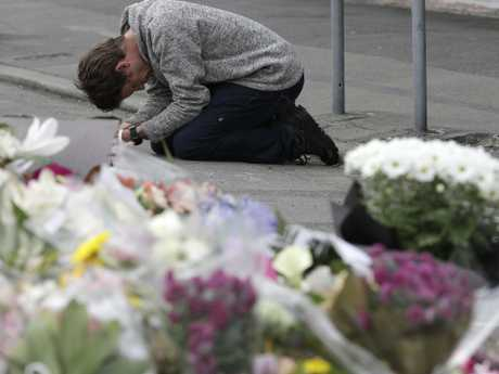 A mourner prays near the Linwood mosque in Christchurch. Picture: AP