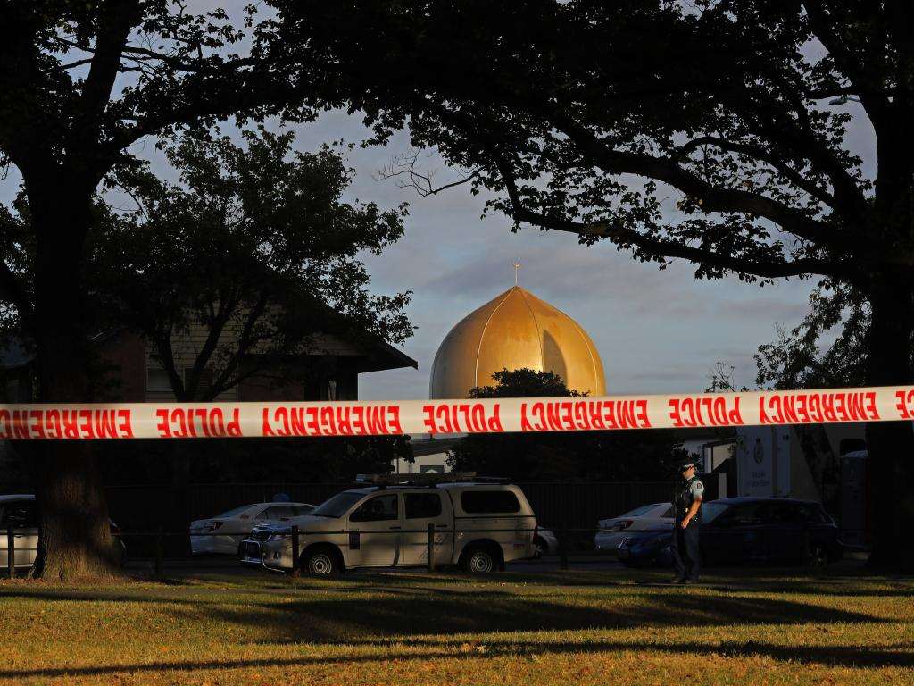 A police officer stands guard in front of the Al Noor mosque in Christchurch. Picture: Vincent Yu/AP