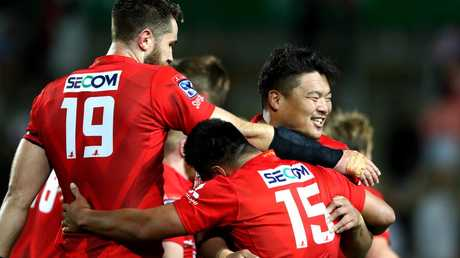 Sunwolves players (l-r) Tom Rowe, Jason Emery and Hiroshi Yamashita celebrate their round three win over the Chiefs earlier this month. Picture: Getty Images