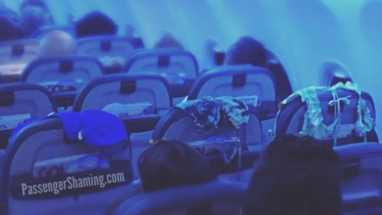 Passenger shamed for drying swimmers on seat during flight. Picture: Passenger Shaming