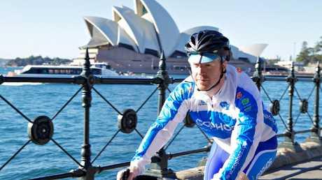 Sydney cyclist with a helmet. Model citizen.