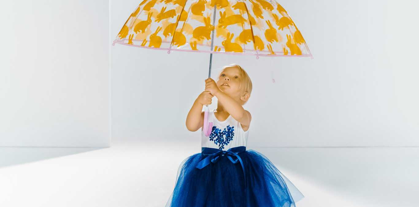 Grand Central's digital runway with children's fashion. Two year old Briar Bridgeman is getting ready to look fashionable in the rain in a dress from Myer, and umbrella & gumboots from Cotton On Kids.