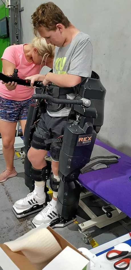 Tristan Sik trials a robotic walking suit earlier in the year, that once he has access will help Tristan learn to walk independently.