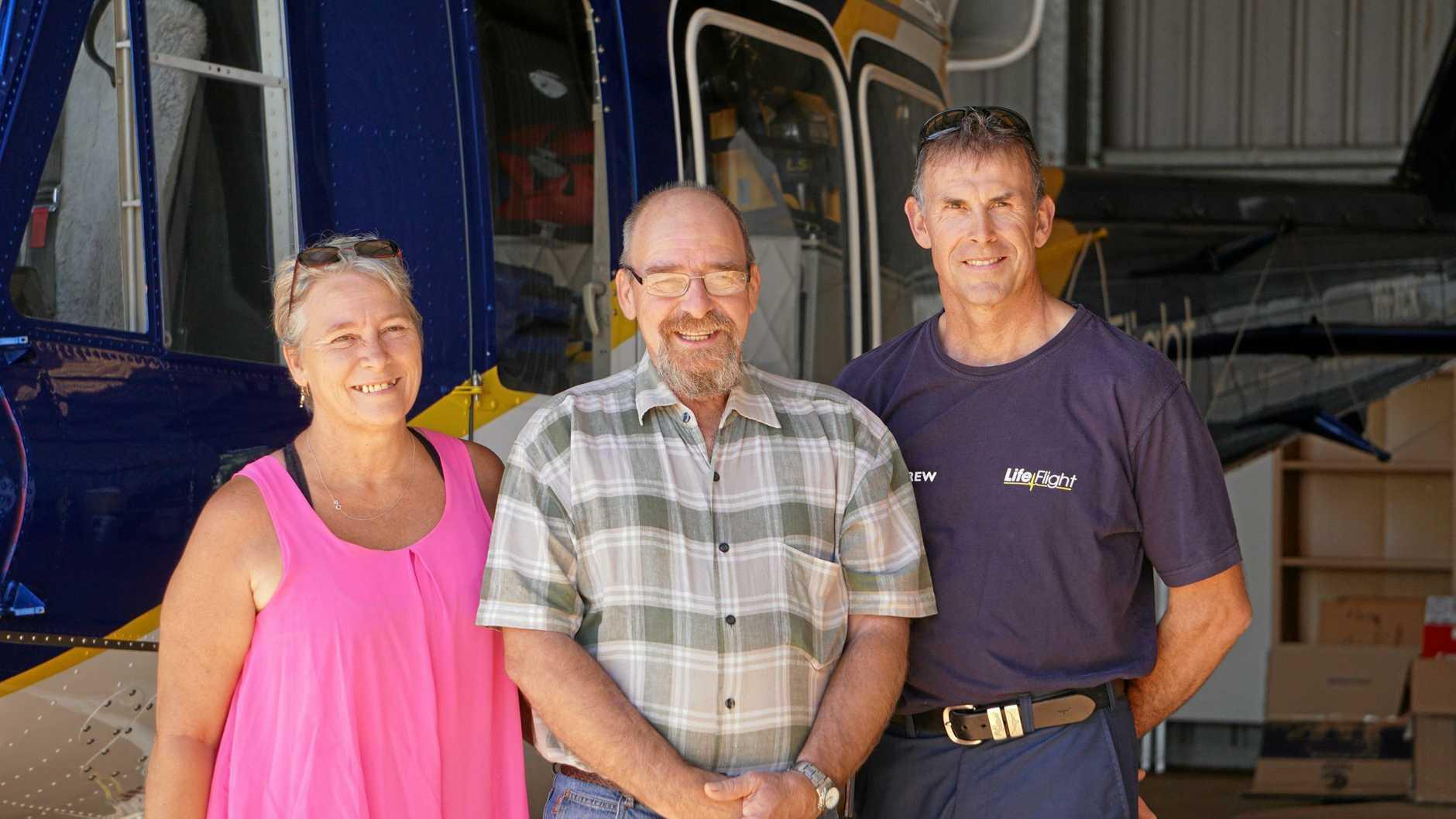 HAPPY REUNION: Helen Gilmore and Peter Gilmore meet LifeFlight pilot Darren Sommers.