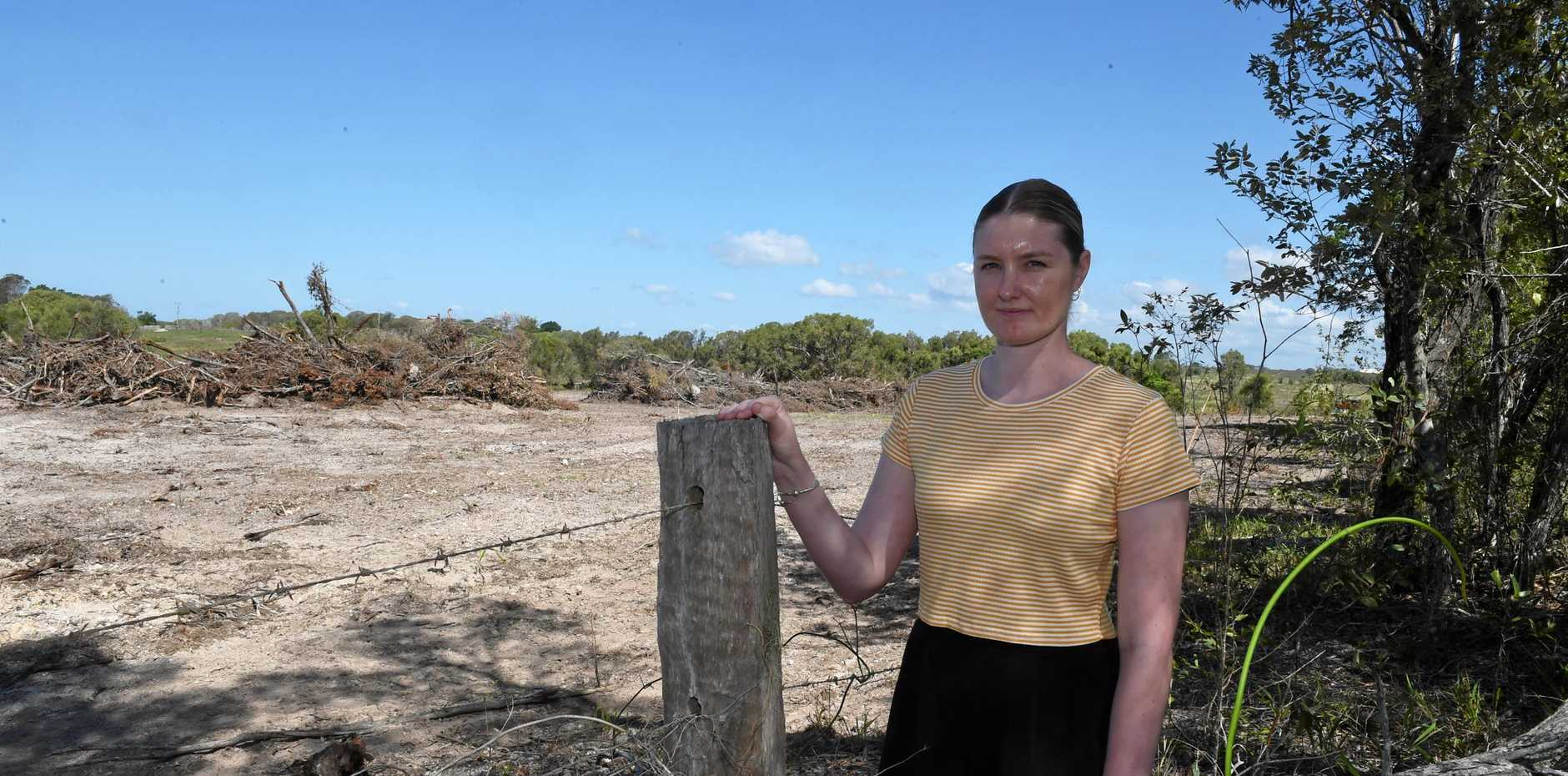 LAND CLEARED: Dundowran resident Becky McIntyre looks out onto the cleared land that will become part of the development of a new housing estate and sports club. Developer Leda Holdings is undertaking preliminary site works for the project.