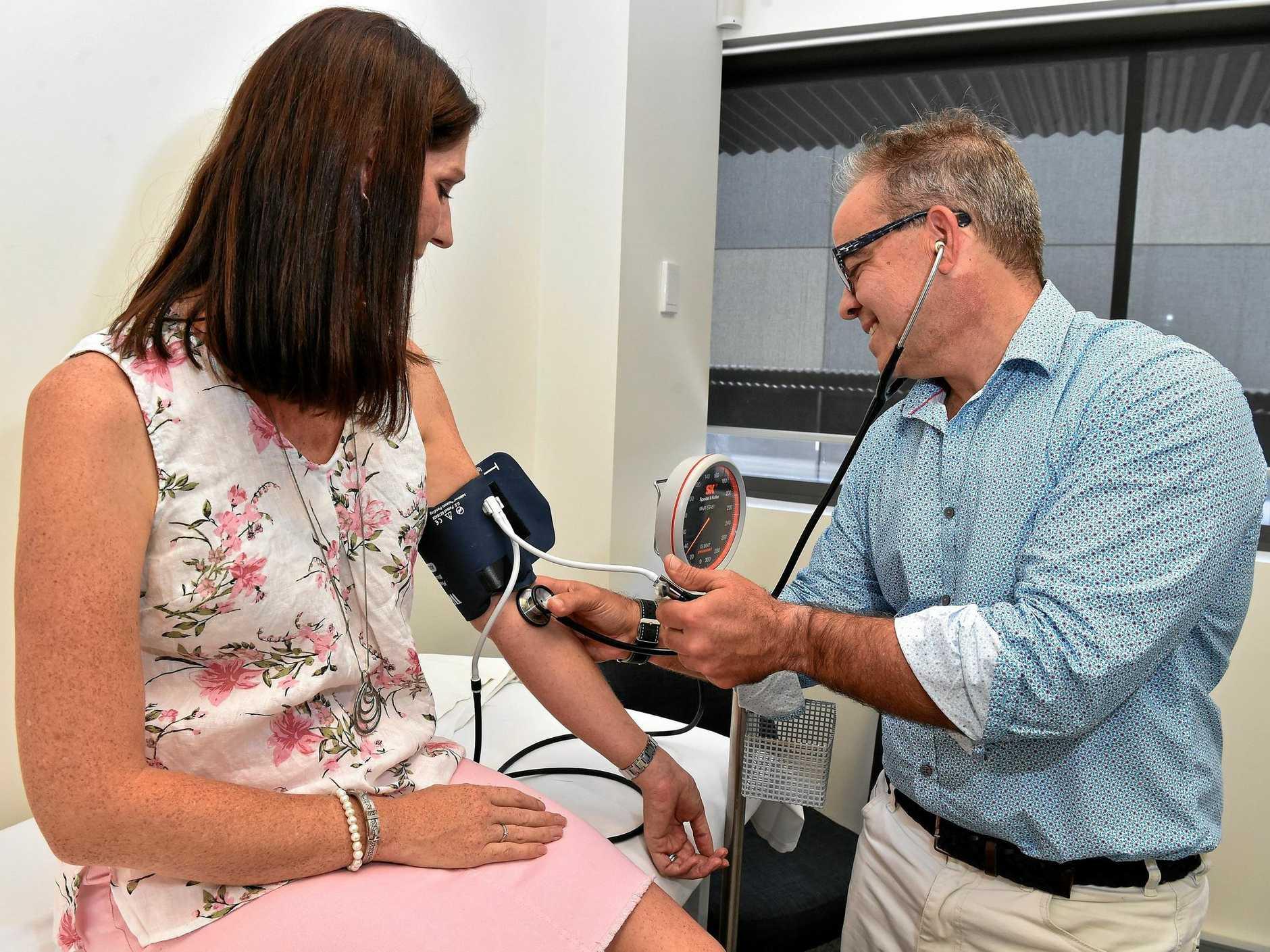 Dr. George Bogiatzis from Sunshine Obstetrics checks the blood pressure of expectant mum Chanelle Shephard.