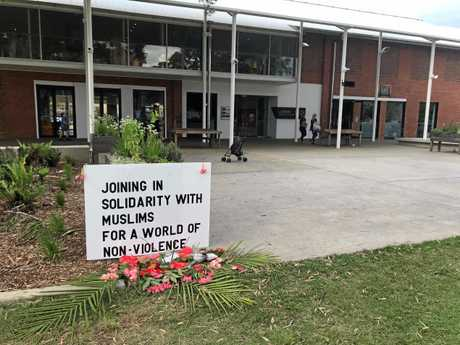 MESSAGES OF PEACE: A sign and a floral offer has been placed at the Lismore Quad about the terrorist attack in Christchurch, New Zealand, last week.