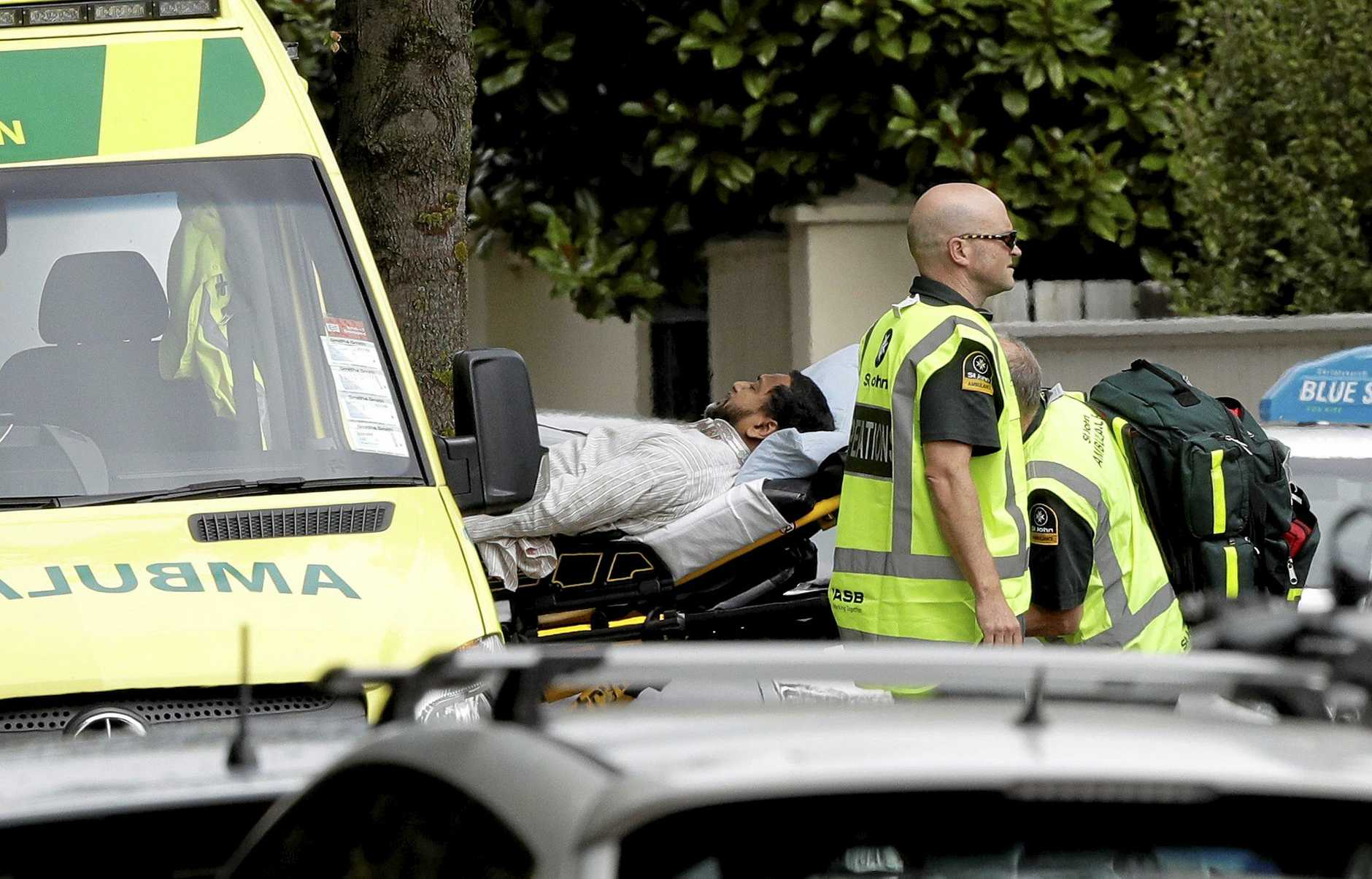 Emergency services respond to the attack at a mosque in Christchurch. The Australian man accused of the attack now faces 50 murder charges.