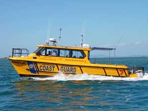 Men rescued by passing barge after boat capsizes