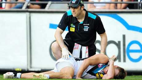 Port Adelaide injures his knee at Etihad Stadium in 2012.
