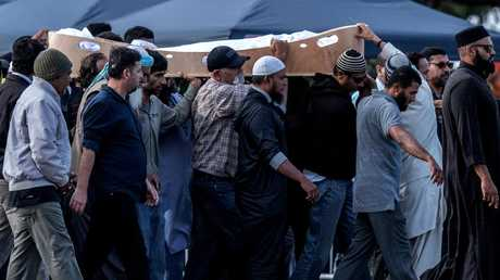 A coffin containing the body of a victim of the Christchurch terrorist attack is carried for burial at Memorial Park Cemetery on March 20, 2019 in Christchurch, New Zealand. Picture: Carl Court/Getty Images.