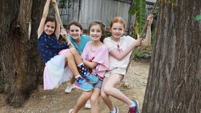 Vivienne Reed, 6, Freya Turner-Jones, 9, Violet Reed, 9, and Josephine Davis, 9, at out of school care in Brisbane. Picture: Claudia Baxter/AAP