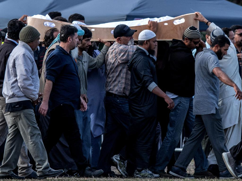 A coffin containing the body of a victim of the Christchurch terrorist attack is carried for burial at Memorial Park Cemetery. Picture: Getty Images