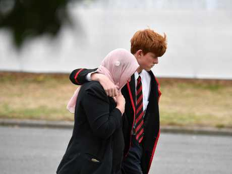 A student from Cashmere High School is consoled after the funeral of his friend Sayyad Ahmed Milne, 14. Picture: Mick Tsikas/AAP