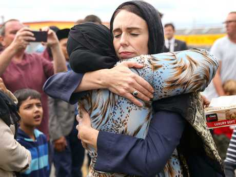 Jacinda Ardern hugs a mosque-goer at the Kilbirnie Mosque in Wellington. Picture: Hagen Hopkins/Getty Images