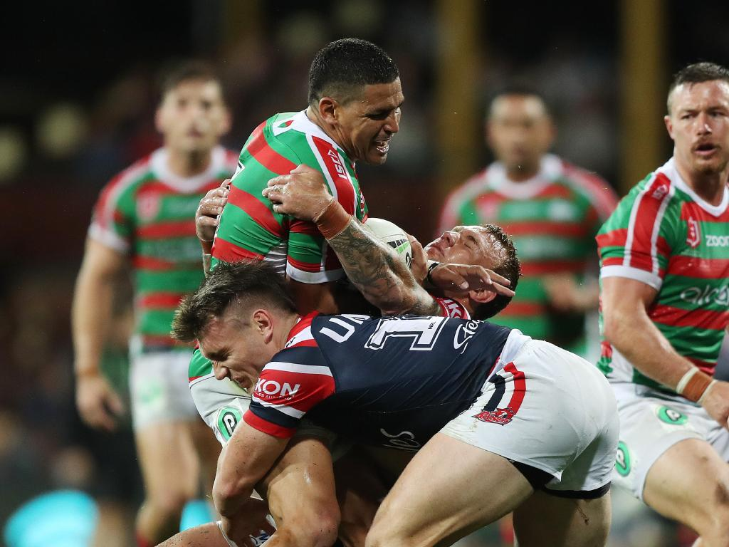 Souths Cody Walker is crunched by new Rooster Angus Crichton in round one. Picture: Brett Costello