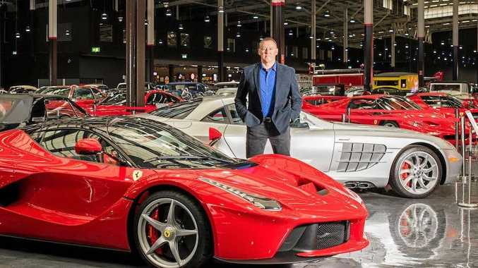 SHARING THE PASSION: Tony Denny with a selection of the exotic marques at the Gosford Classic Car Museum, which he aimed to make Australia's largest dealership, while also displaying the biggest privately owned collection of classic cars in the Southern Hemisphere.