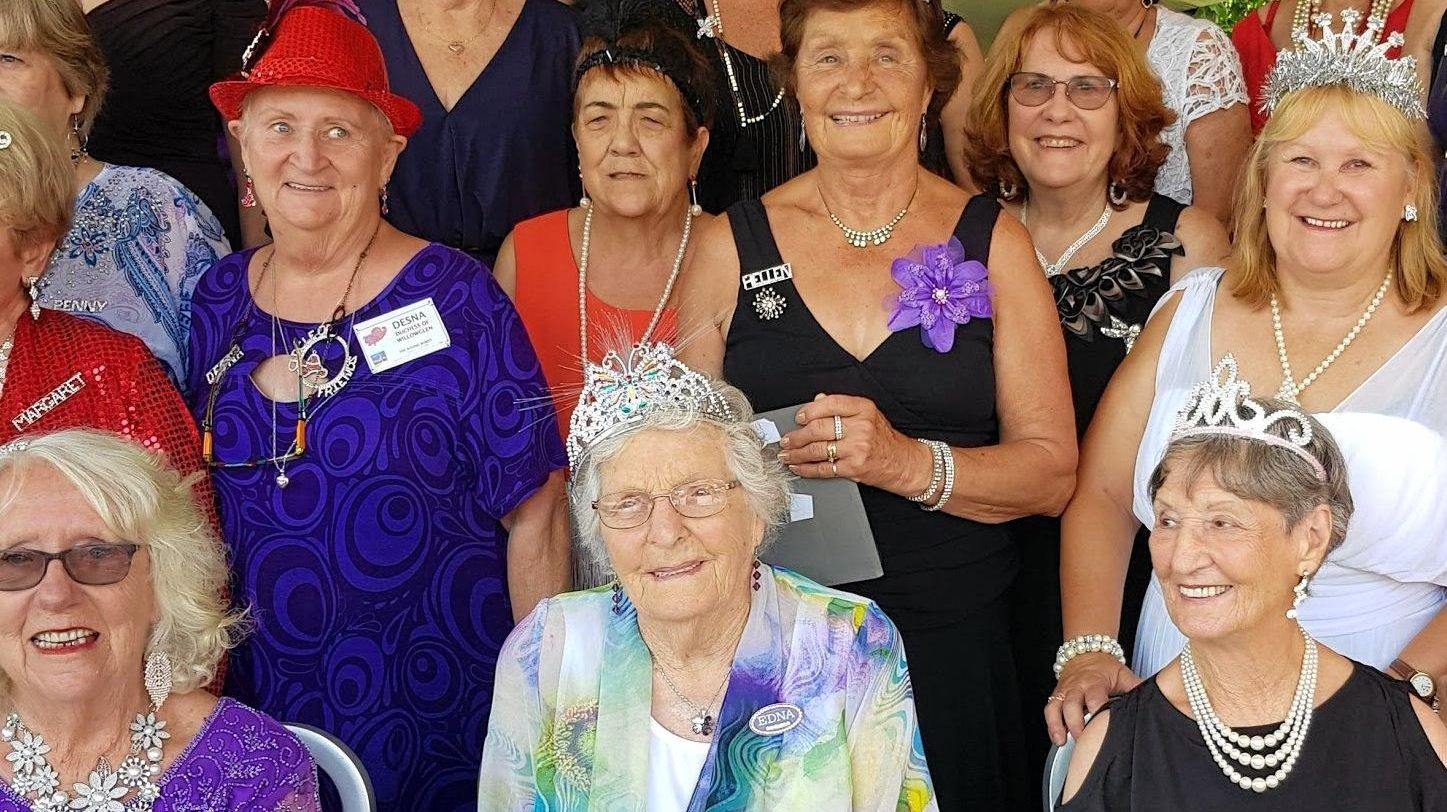 PARTY TIME: Edna Fowler, front centre, celebrates her 95th birthday with members of the Roving Rubies Red Hatters.